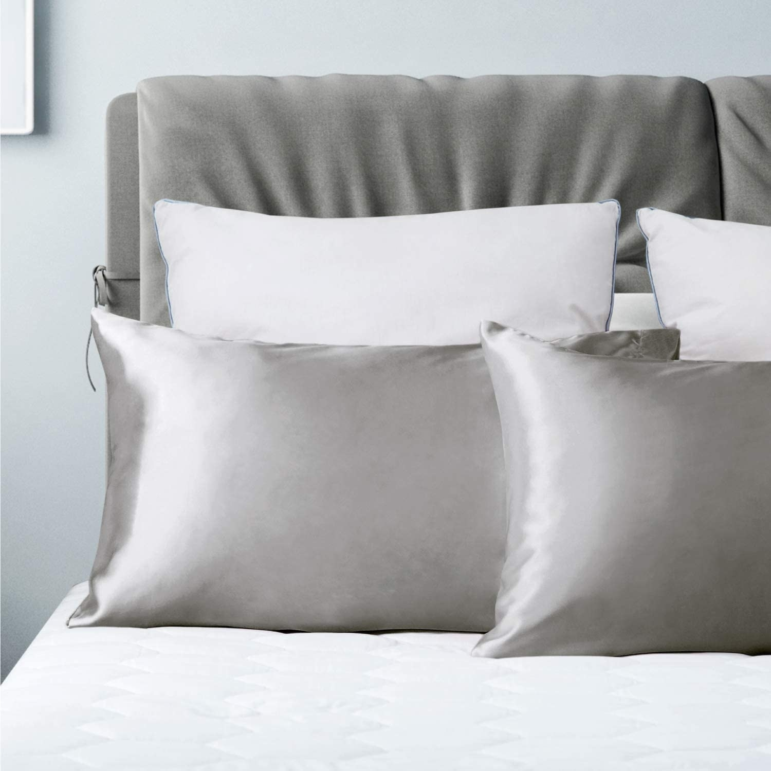 Two satin pillowcases on a bed