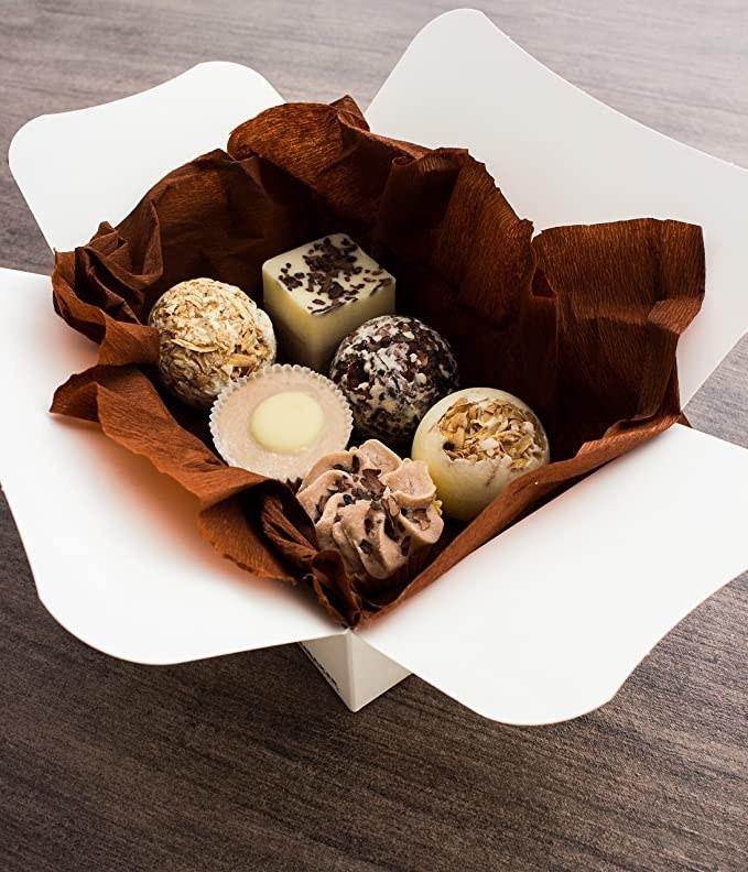 A box with six bath bombs that look like chocolate truffles