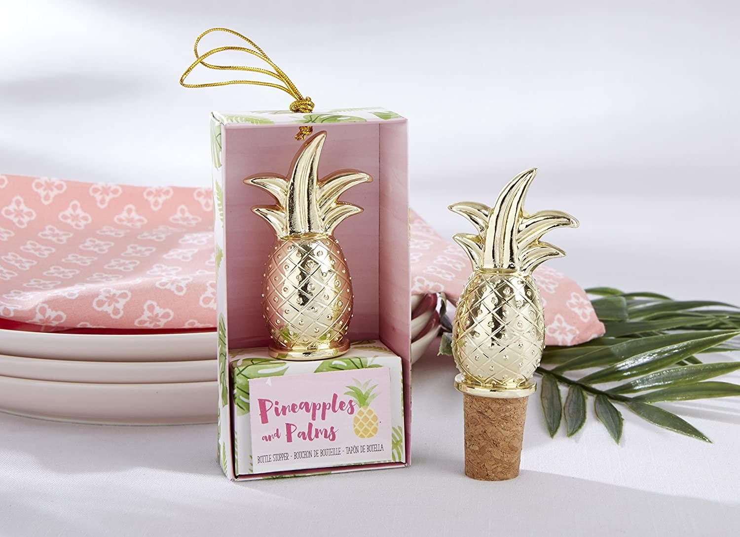 A pineapple wine stopper in a package and a pineapple wine stopper showing the cork