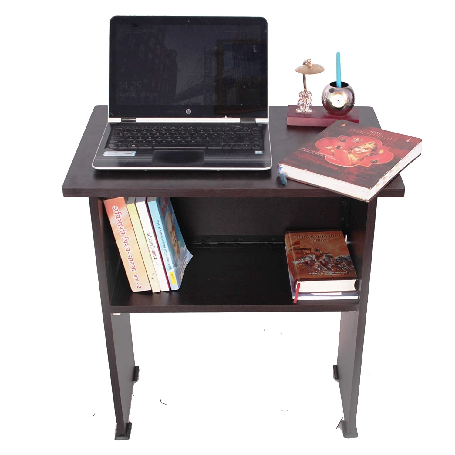 A wooden table with a laptop, books, and some stationery on it