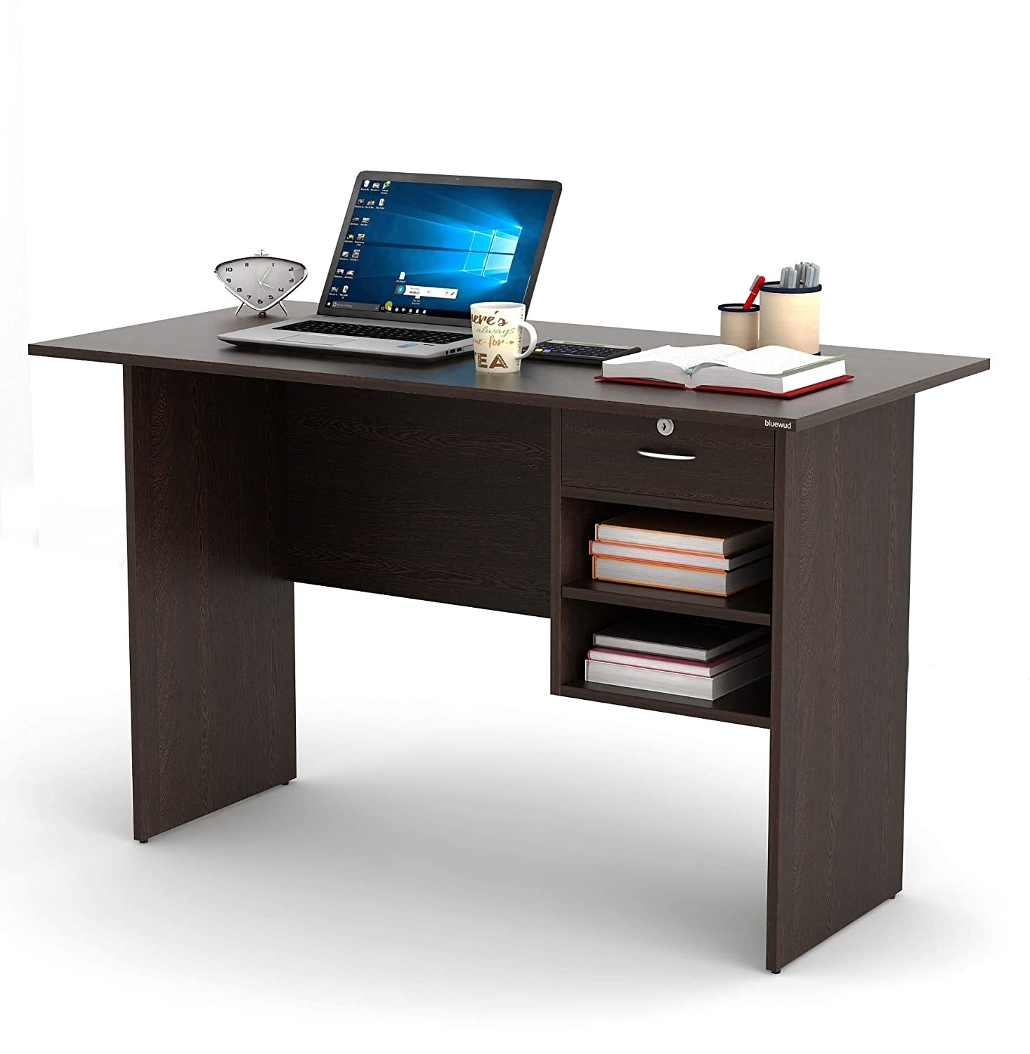 A desk with a laptop, books, and multiple stationery items on it