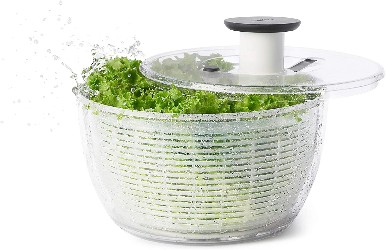A plastic salad spinner full of lettuce.