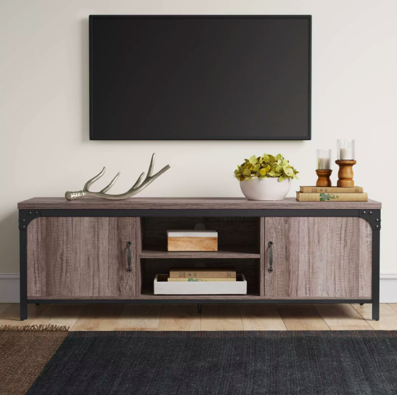 Rustic wood and black trim media cabinet with television mounted above