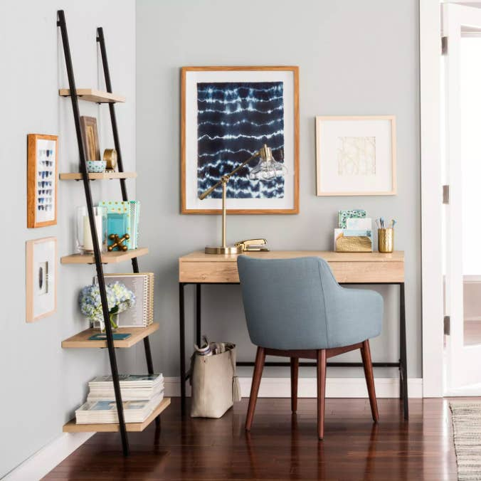 Light wood writing desk with pale blue chair and lamp
