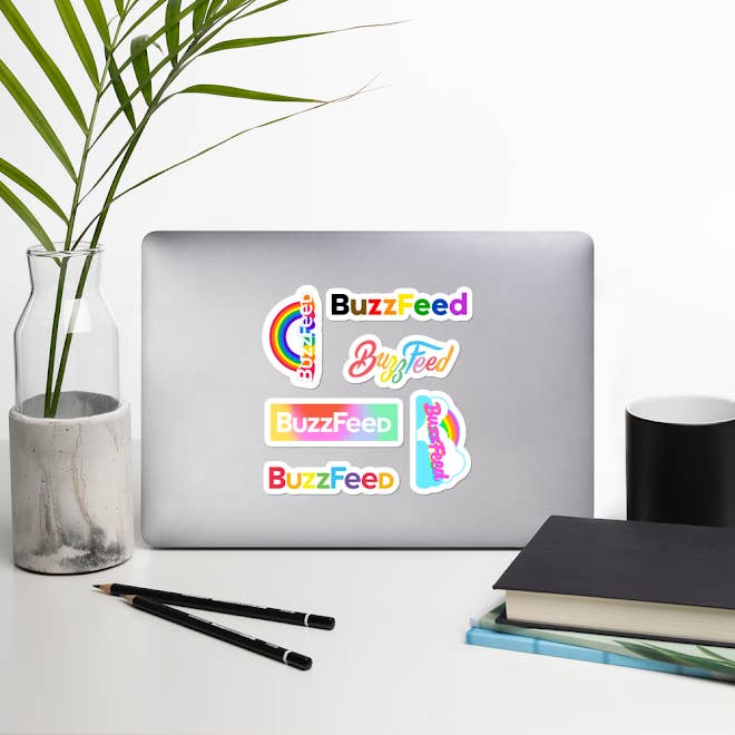 Six stickers that say BuzzFeed in a variety of designs and rainbow colors