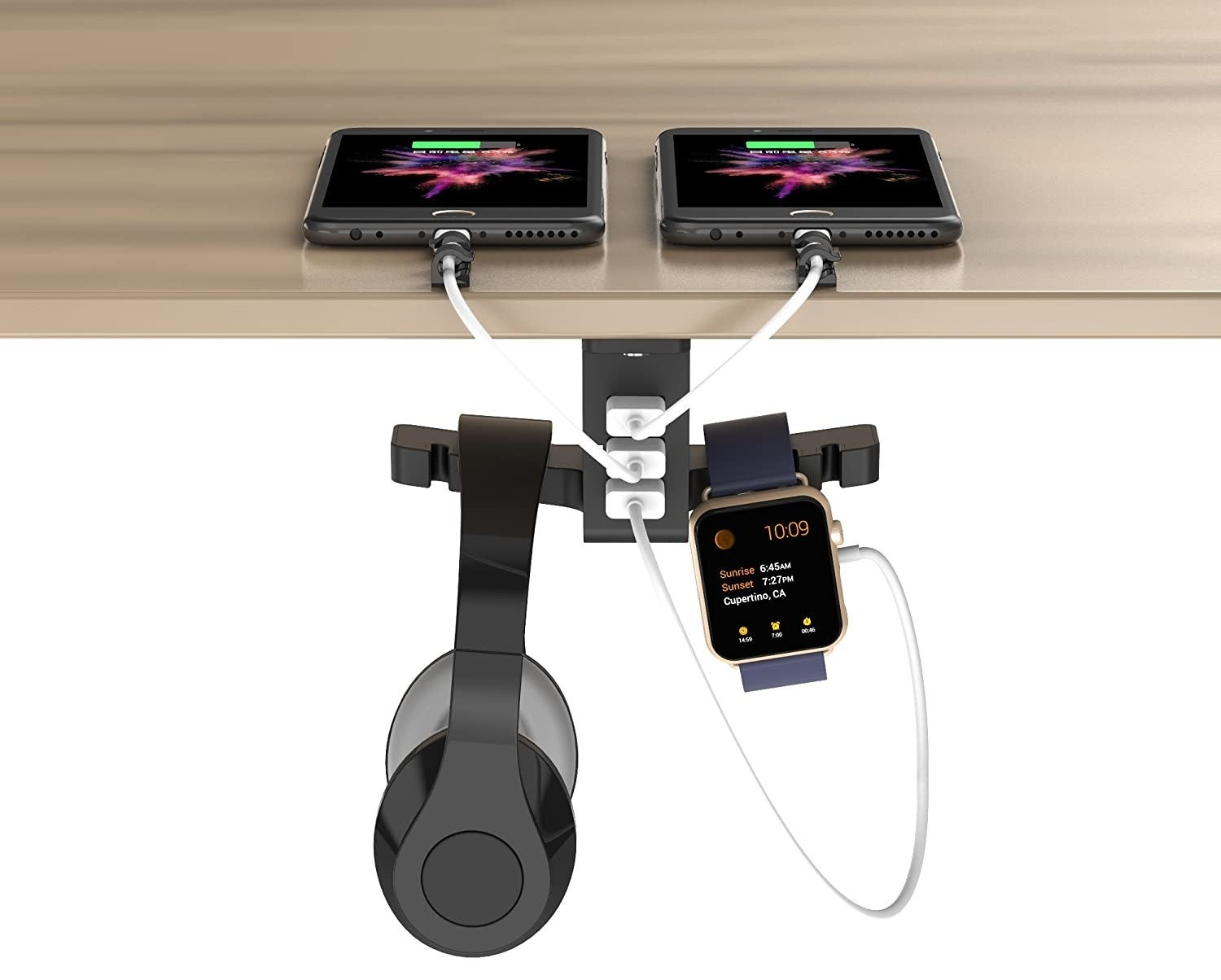 A pair of headphones and a digital watch hang from a hook under a table A pair of phones sit on the table