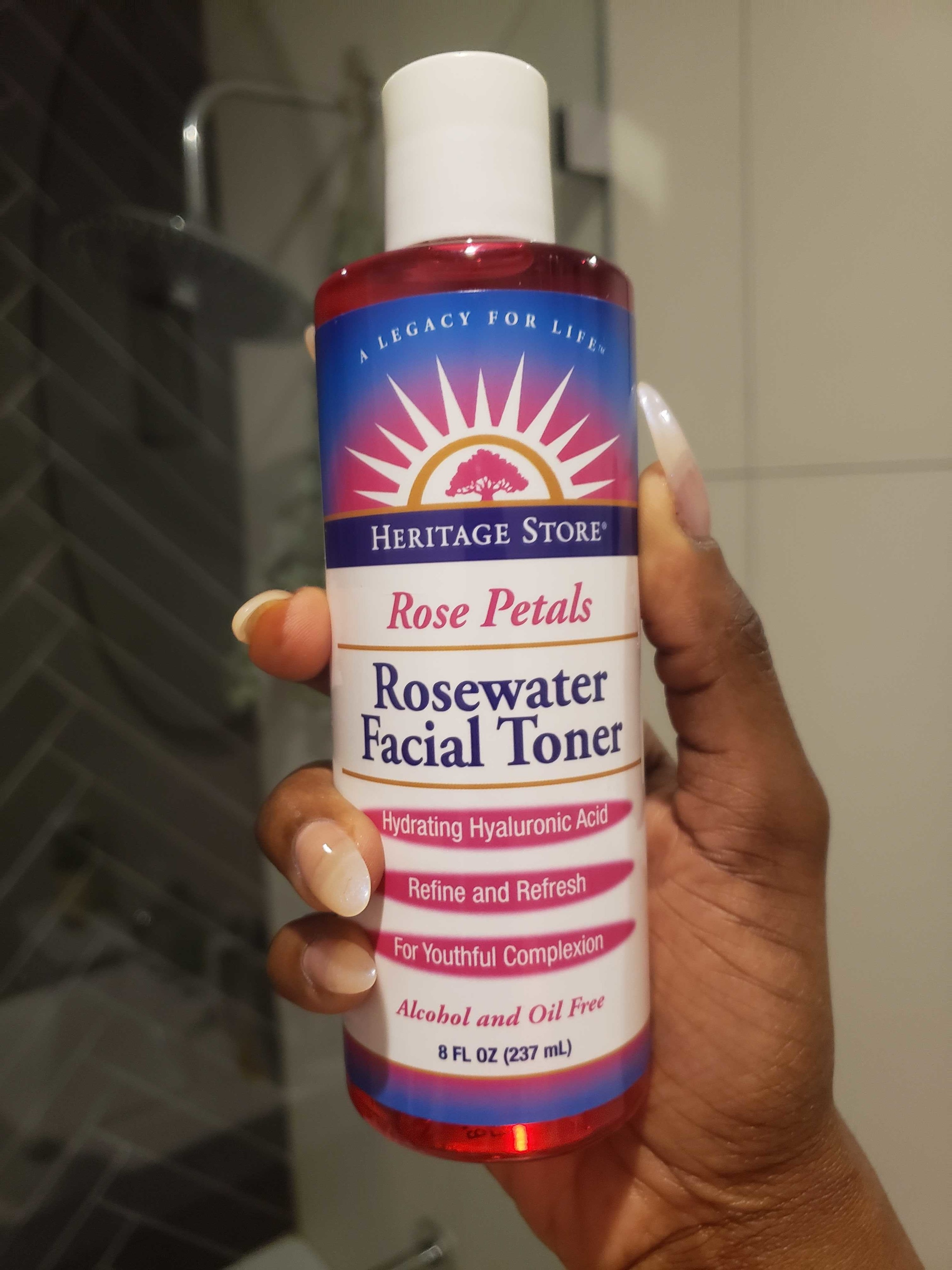 BuzzFeed writer Marquaysa's hand holding the toner which has a twist-off top