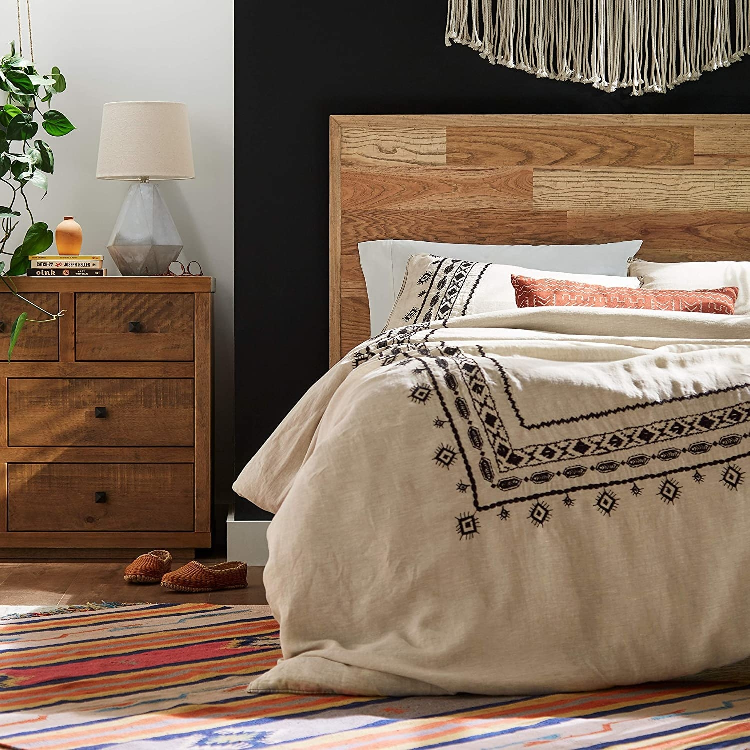 a white linen duvet cover with black geometric embroidery