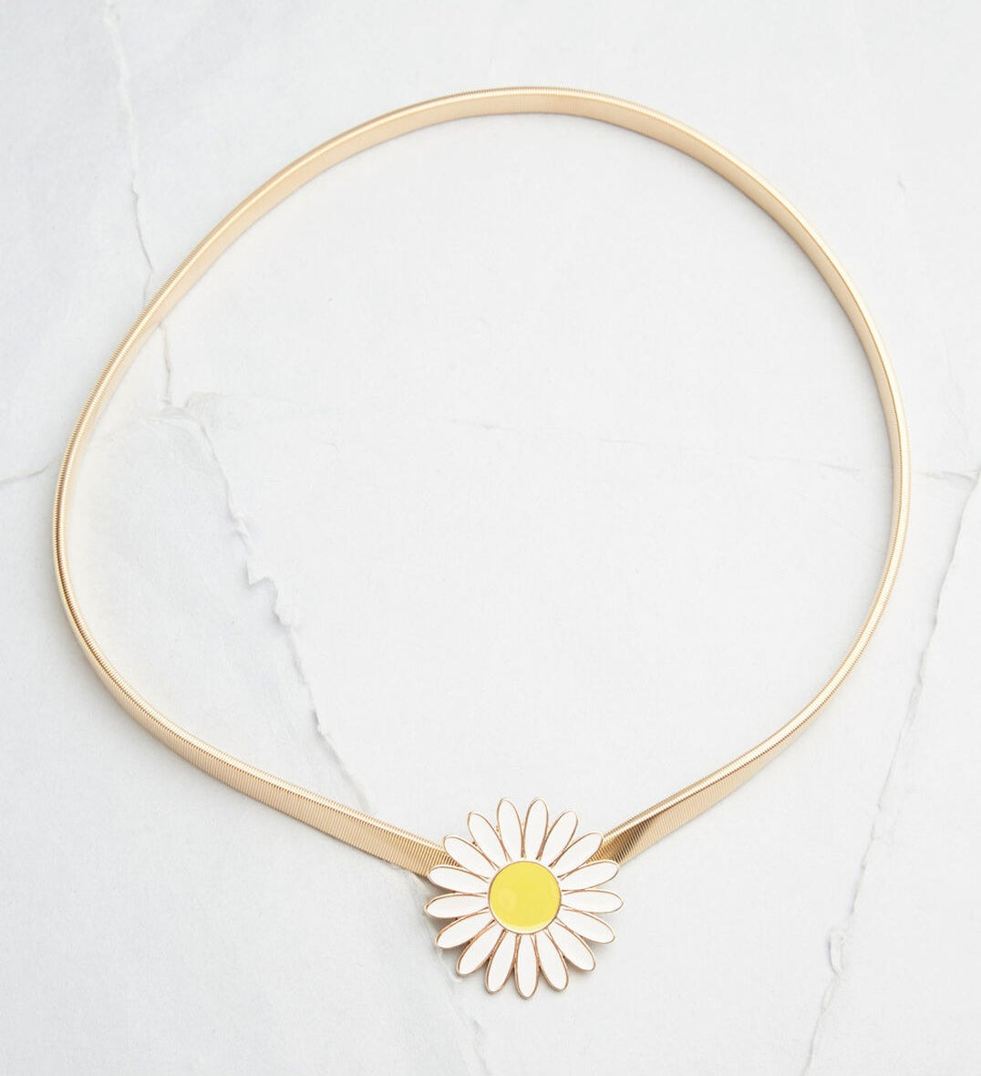 Gold belt with a white daisy with yellow center