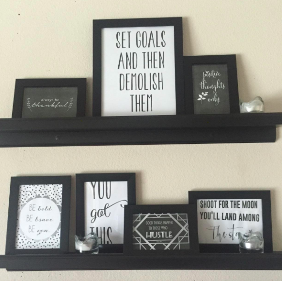 A customer review photo of the frames displayed on multiple shelves.