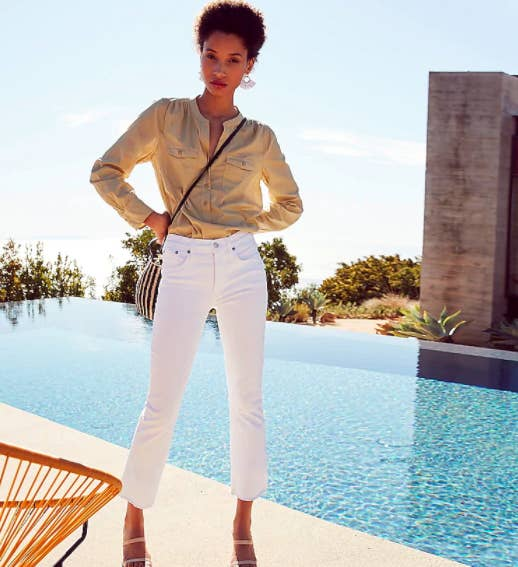 """Model wearing white J.Crew 9"""" demi-boot crop jeans in white that hit right above ankles"""