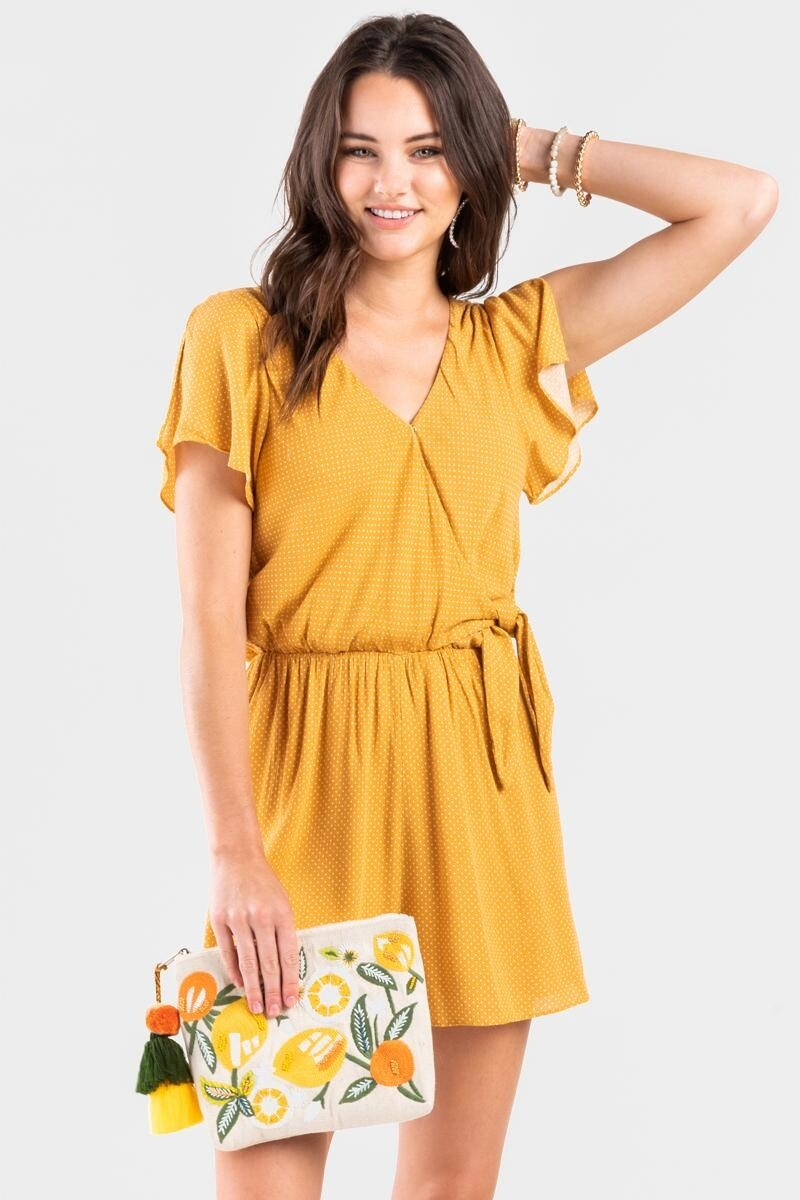 Model wearing the romper in yellow
