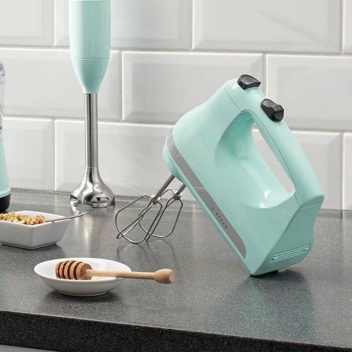 The mixer in pastel blue resting upright
