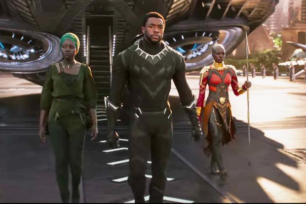 T'Challa (Chadwick Bosman) returns to Wakanda, flanked Nakia (Lupita Nyong'o) and Okoye (Danai Gurira).