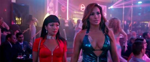 Destiny (Constance Wu) and Ramona (Jennifer Lopez) strut through a strip club.