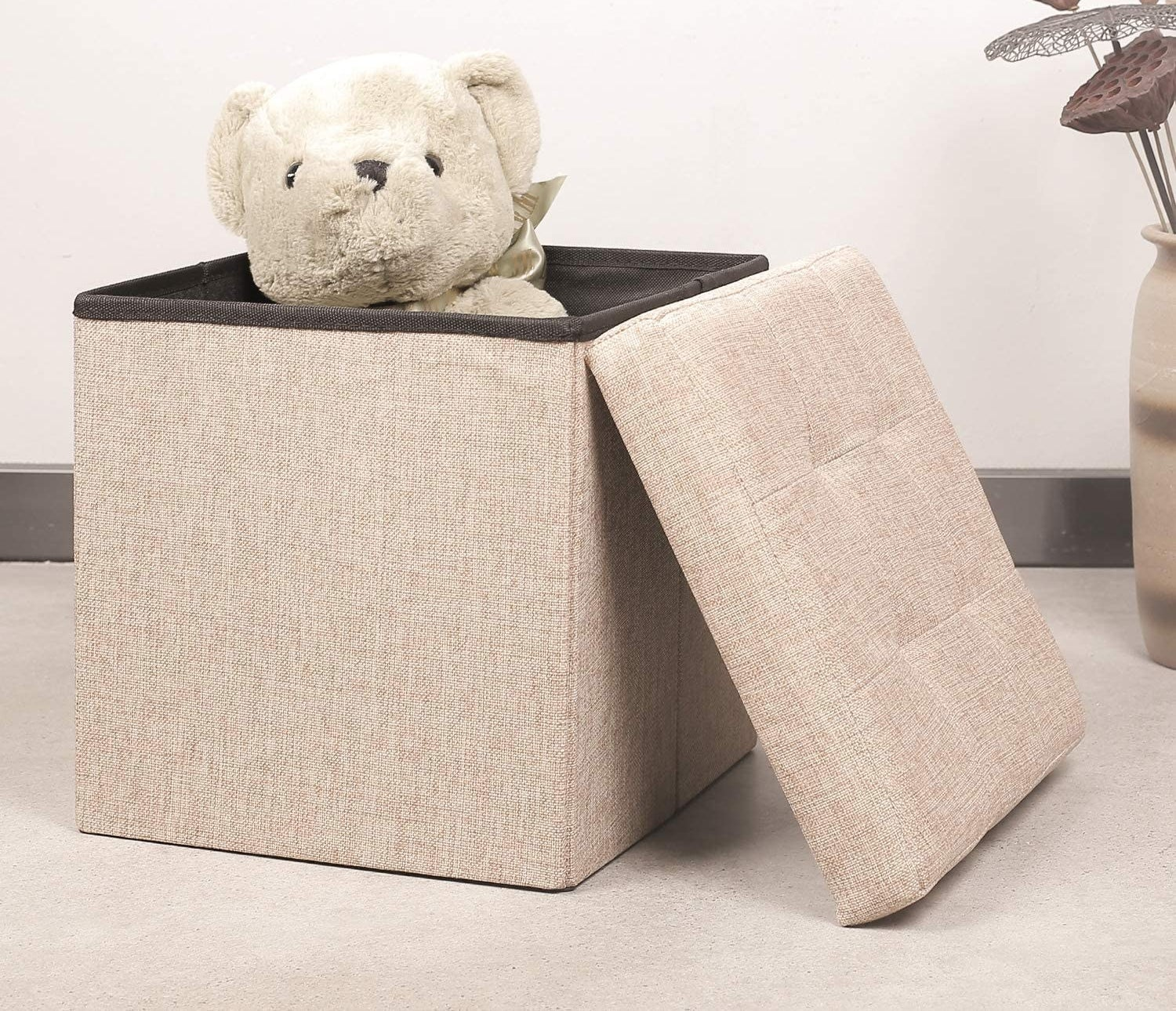 The storage ottoman in yellow linen.