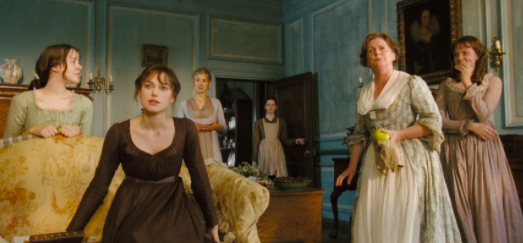 The Bennet ladies (from left to right: Jena Malone, Keira Knightley, Rosamund Pike, Talulah Riley, Brenda Blethyn, and Carey Mulligan) excitedly learn of the arrival of a suitor.