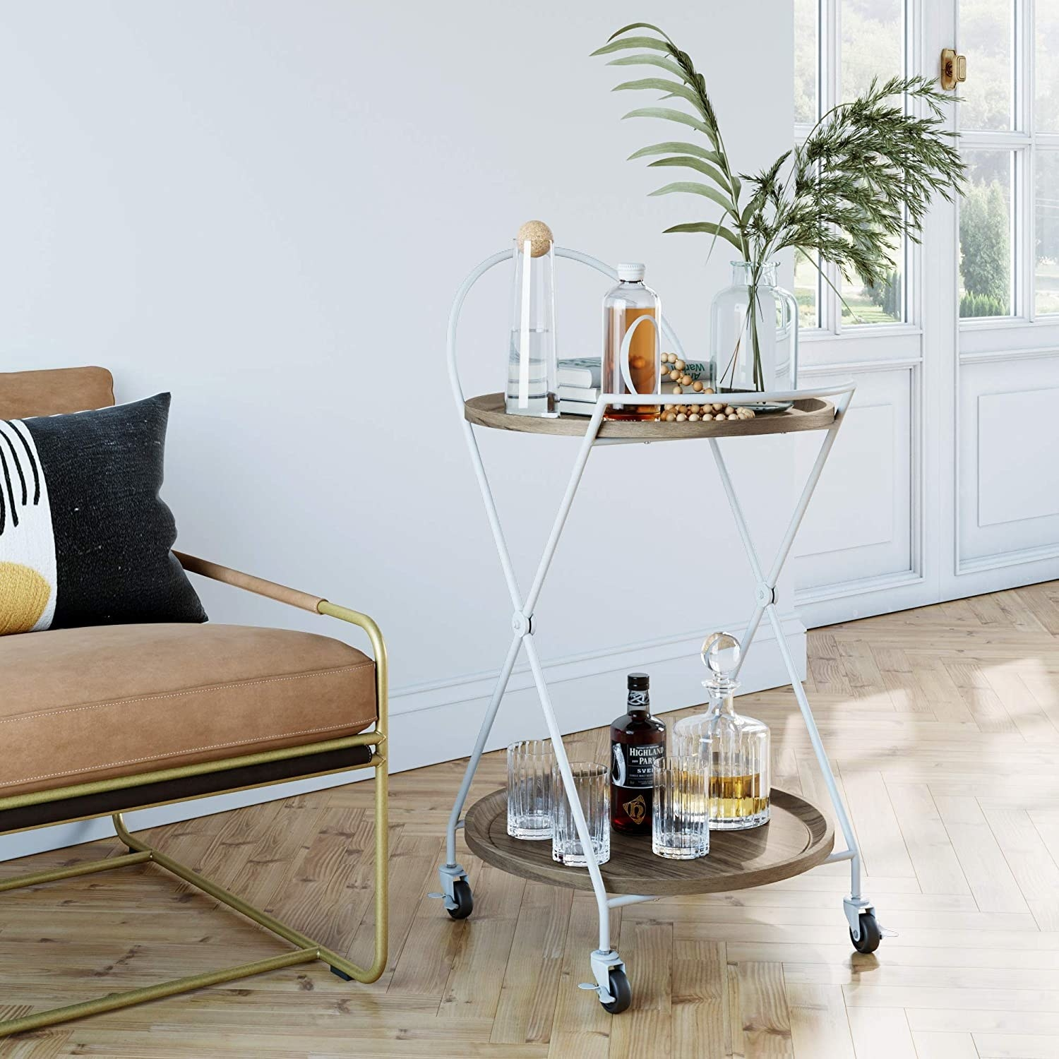 The bar cart in white with criss-cross legs and four wheels