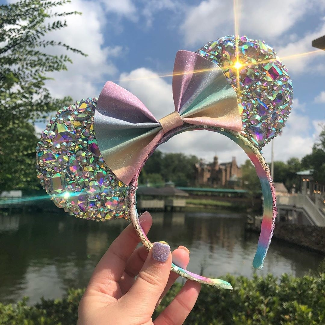 a completely bedazzled pastel set of minnie mouse ears gleaming in the sunlight