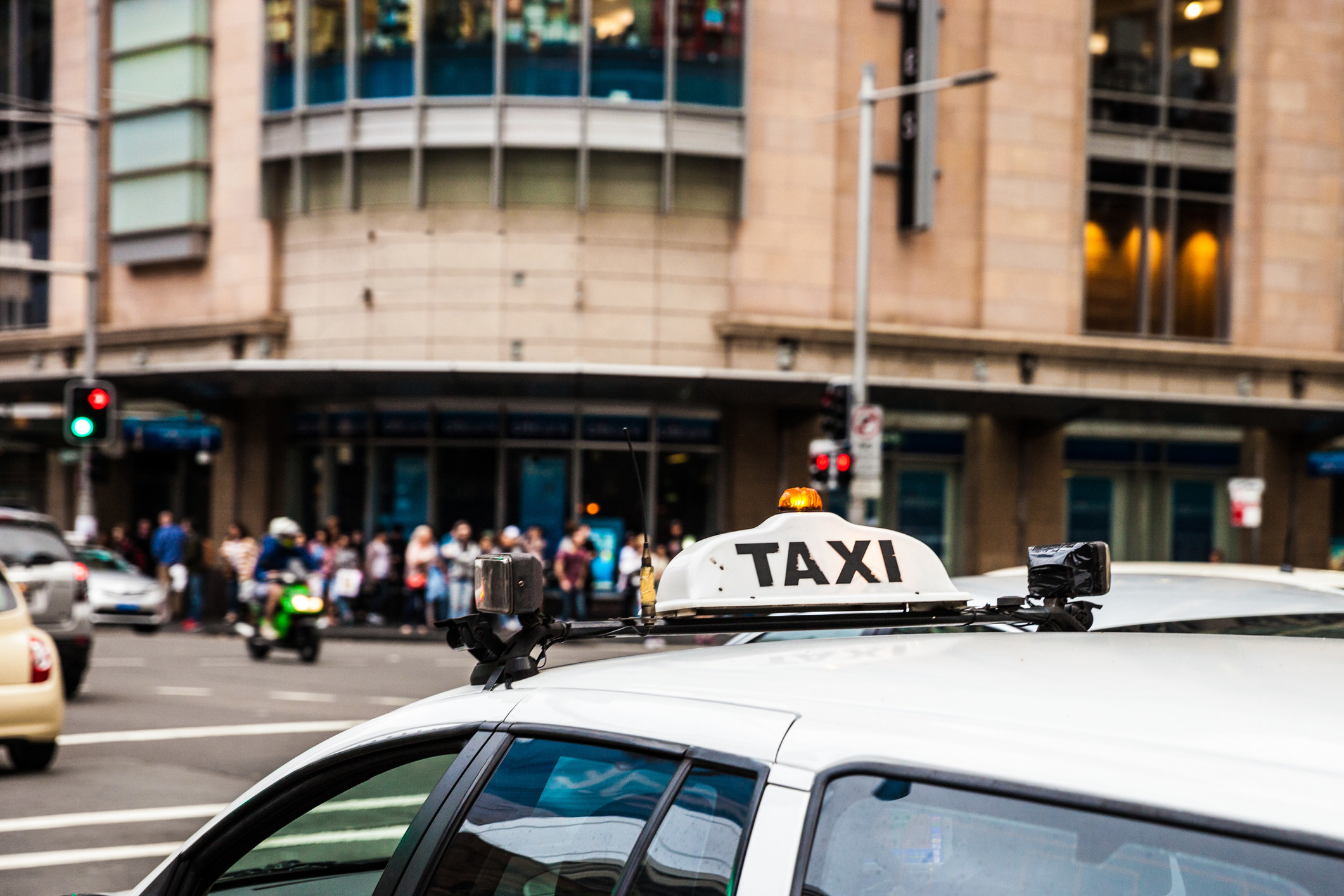 the roof of a taxi driving in Sydney, Australia