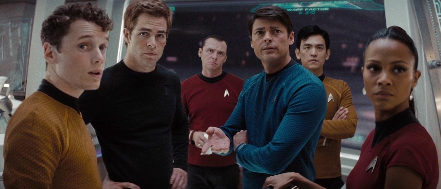 The new Enterprise team (from left to right: Anton Yelchin, Chris Pine, Simon Pegg, Karl Urban, John Cho, Zoey Saldana) look on to the adventure that lies ahead.