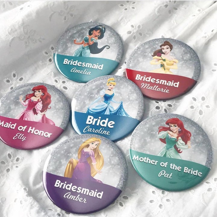 six different pins, each featuring a disney prince and the different members of the bridal party