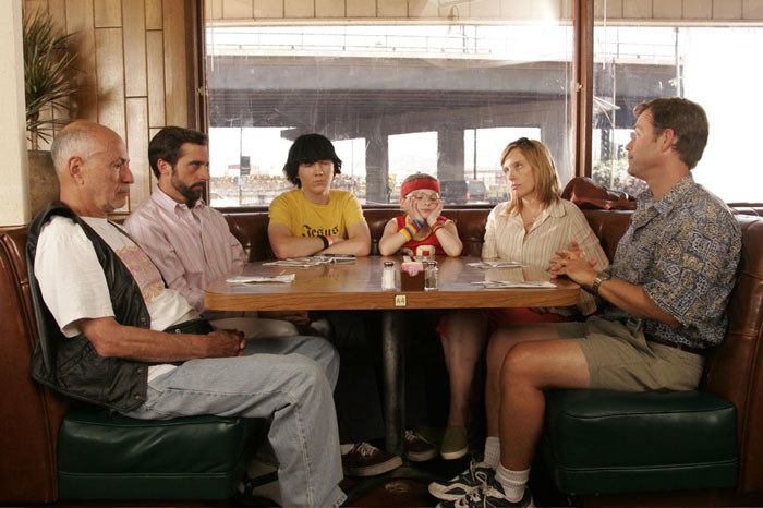 The Hoover family (from left to right: Alan Arkin, Steve Carell, Paul Dano, Abigail Breslin, Toni Collette, and Greg Kinnear) prepare to enjoy a very awkward meal together at a roadside diner.