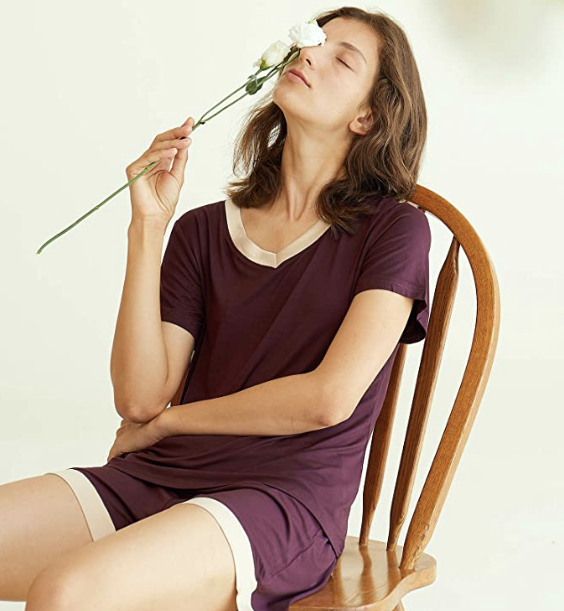 A model in a maroon pajama set with shorts and a v-neck tee