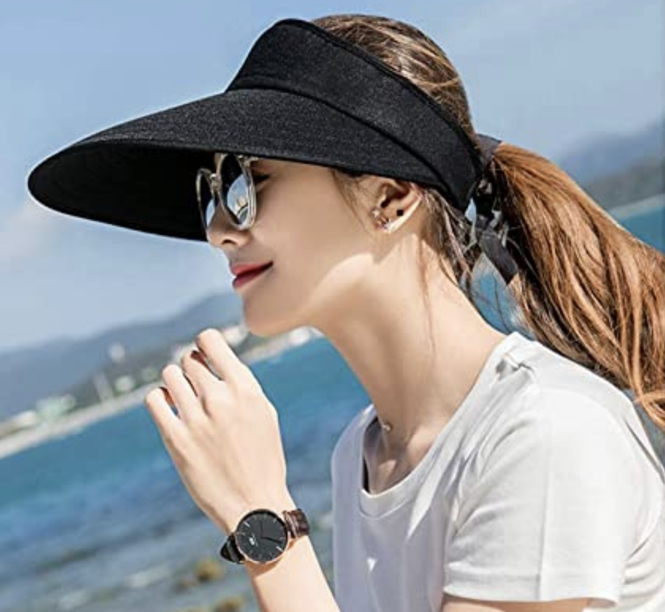 A model in a visor that shadows her face from the sun
