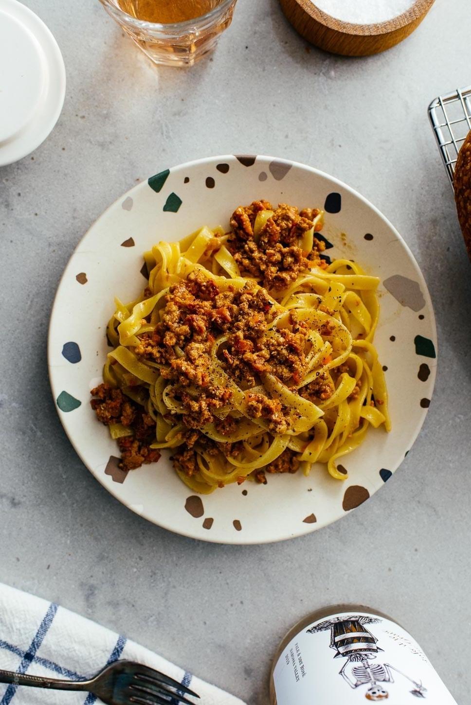 A plate of tagliatelle pasta with pork ragu.