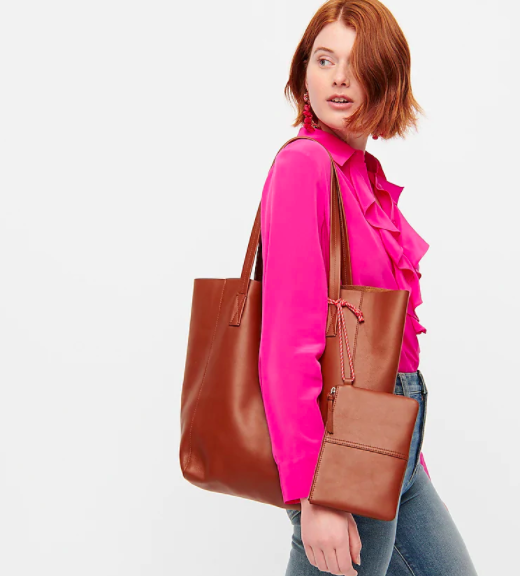 Model carrying the J.Crew carryall tote in warm sepia colorway