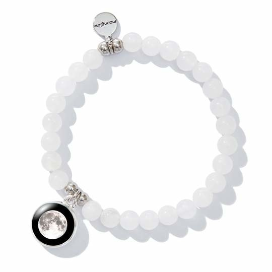 The bracelet, which has a moon photo charm and a small silver engraved charm