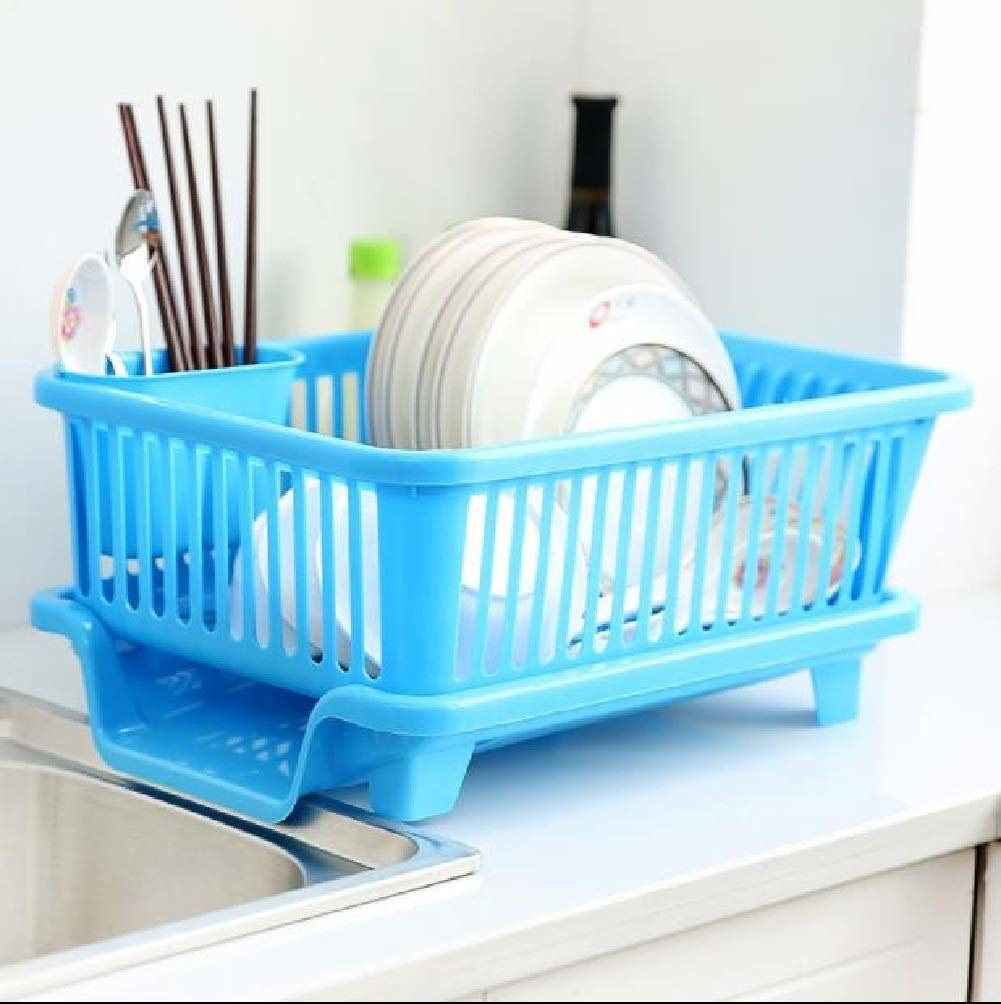 A blue dish drying rack by the sink