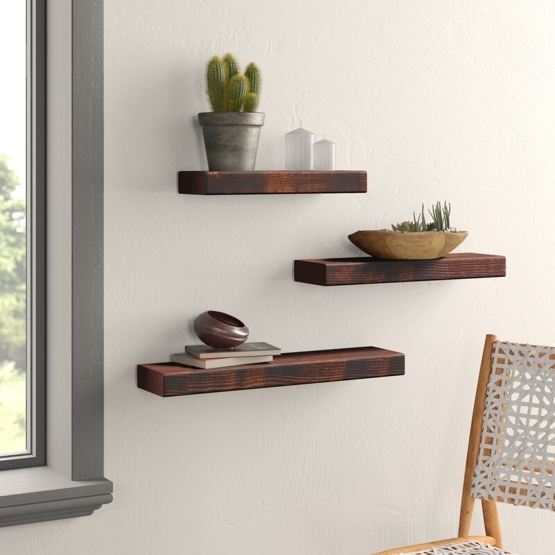 The shelves in a dark walnut finish