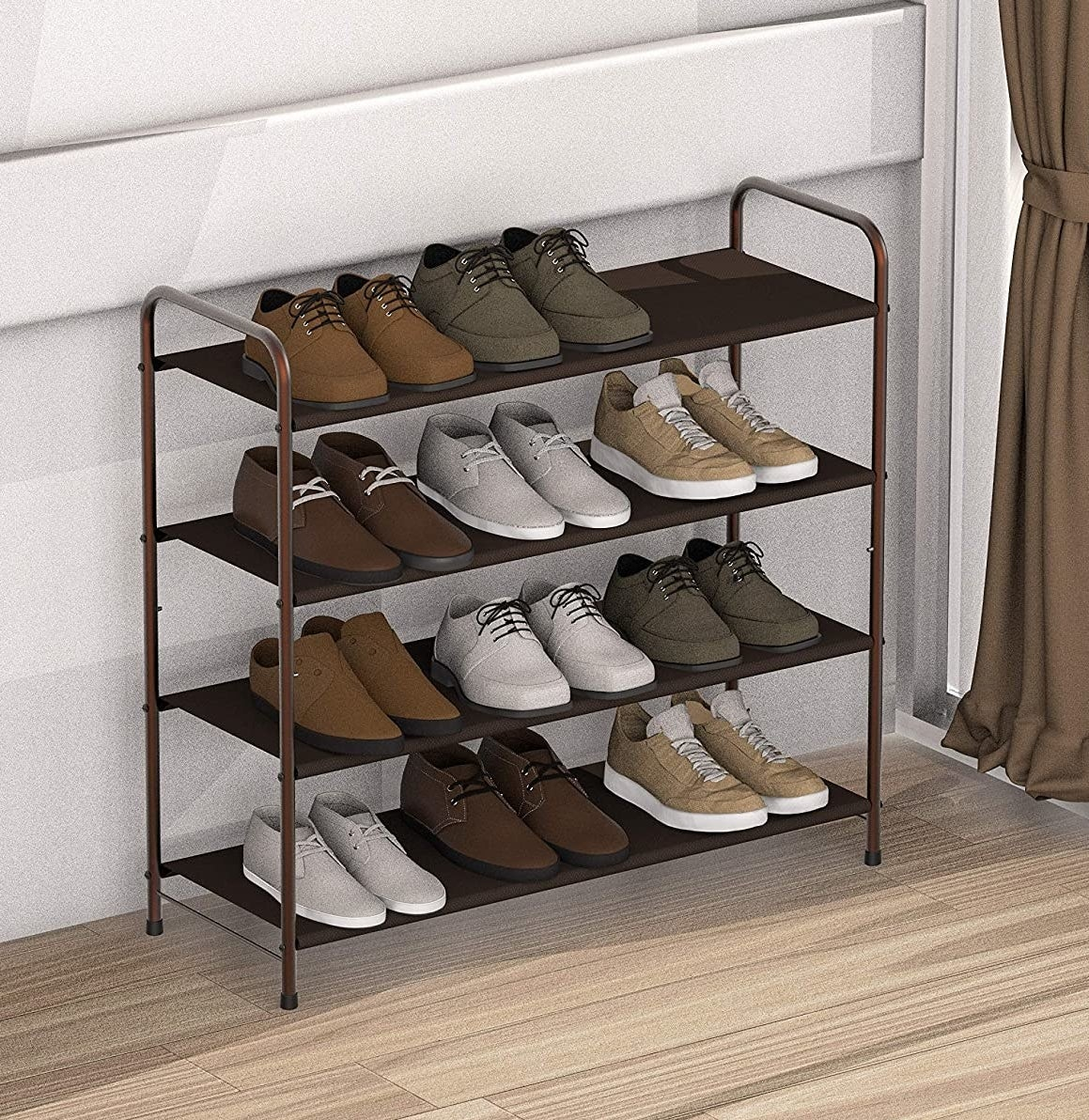 A four-tier shoe rack with eleven pairs of shoes on it