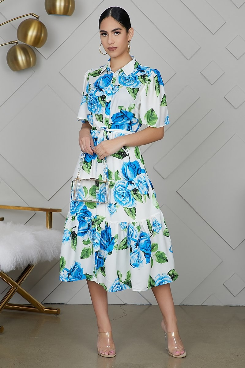 Model wearing the blue floral dress