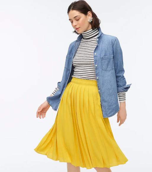 Model wearing the J.Crew pleated midi skirt in golden sun colorway