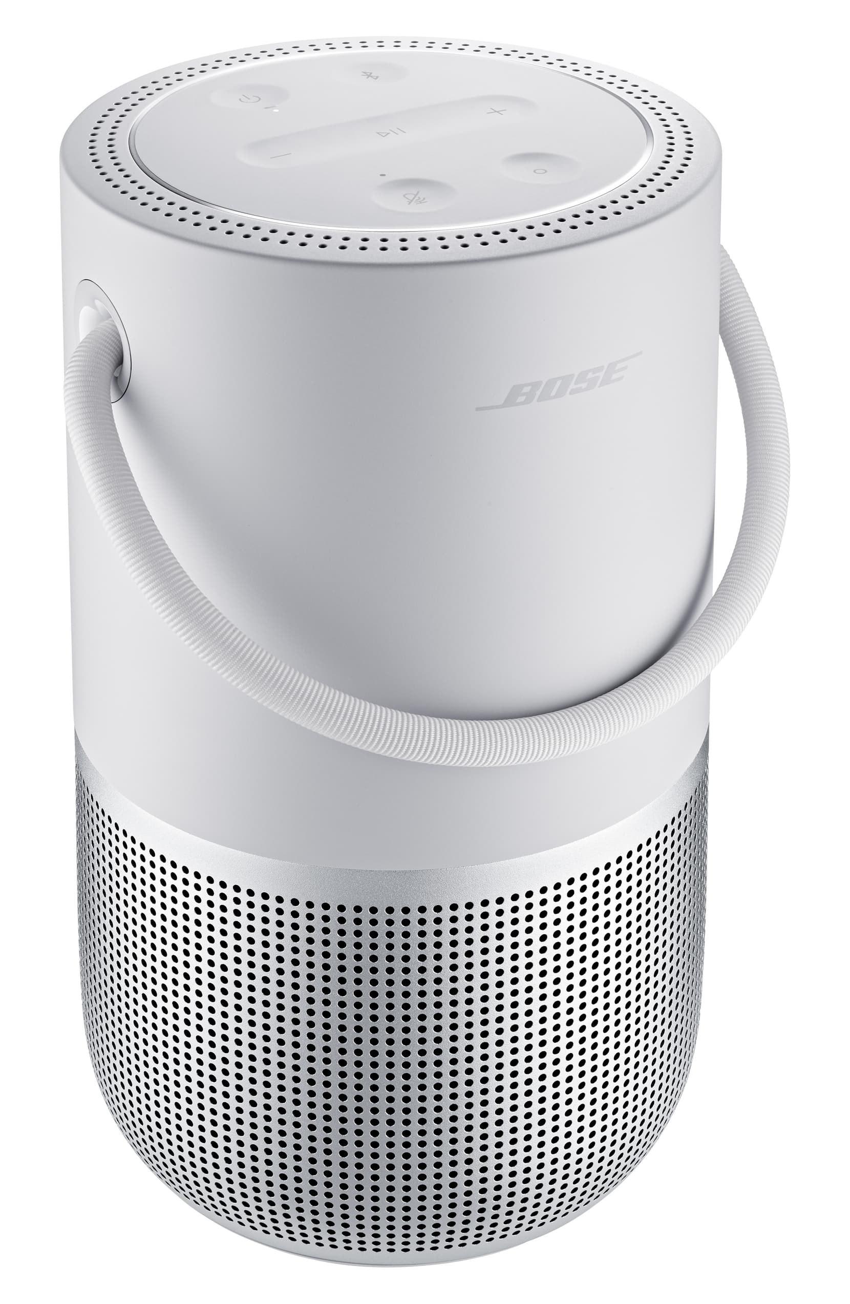 White portable Bose bluetooth speaker upright
