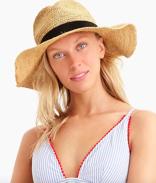 Model wearing the J.Crew wide-brim packable straw hat