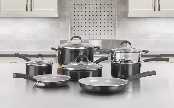 A black 11-piece set of non-stick cookware on a tabletop