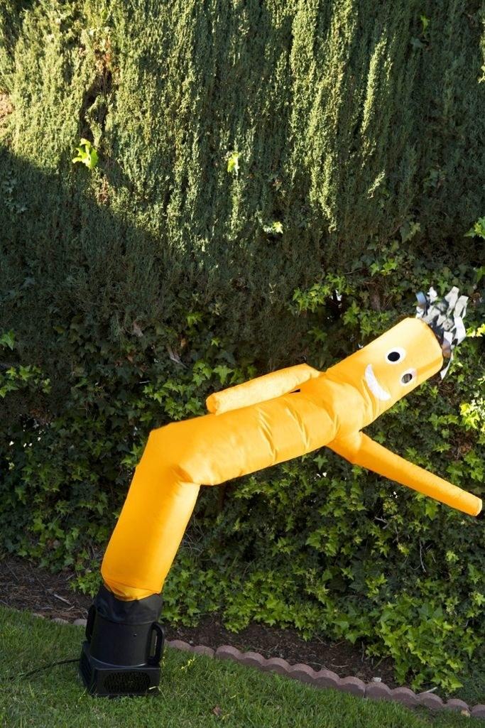 large yellow tube man set up outside