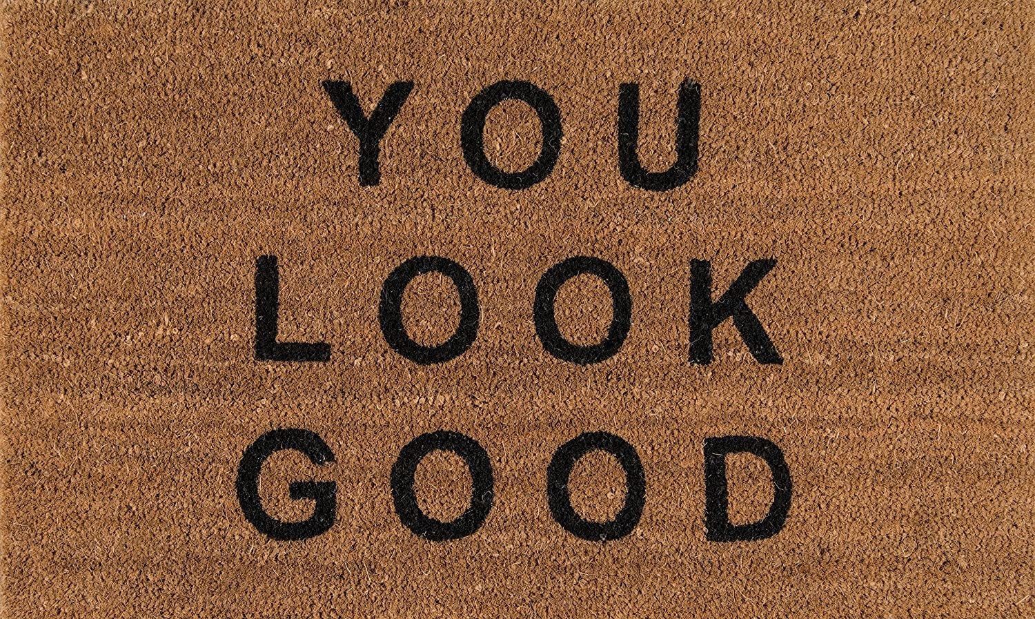 "A natural doormat that says ""You Look Good"" in black letters"