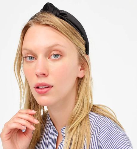 Model wearing the J.Crew satin knot headband in black colorway