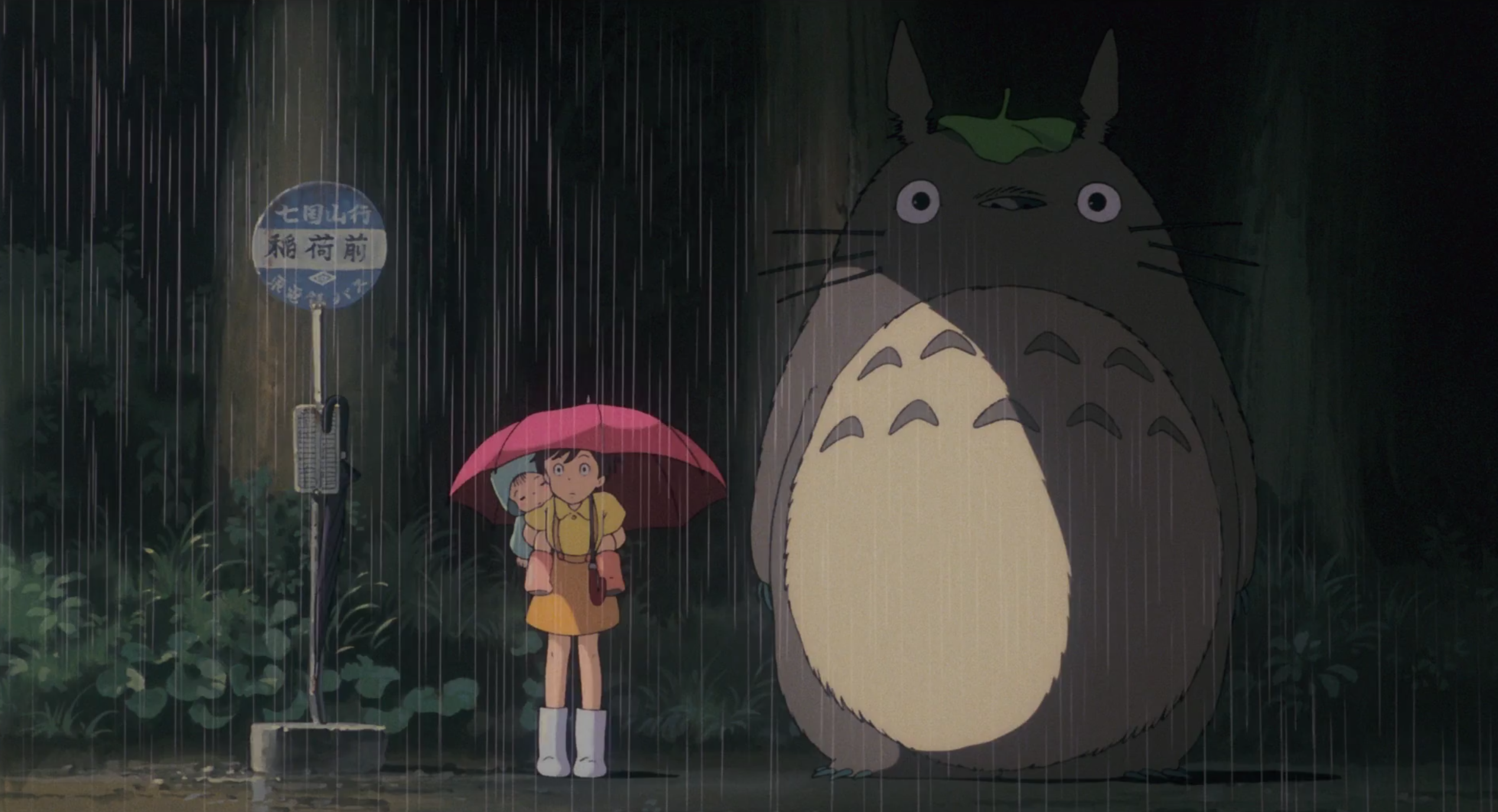 Screenshot of the sisters and Totoro at a bus stop