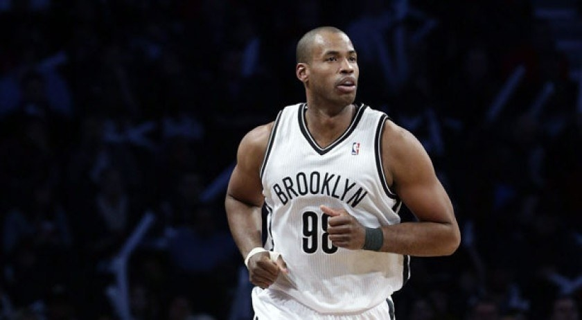 Collins on the court playing for Brooklyn in his 98 white jersey.