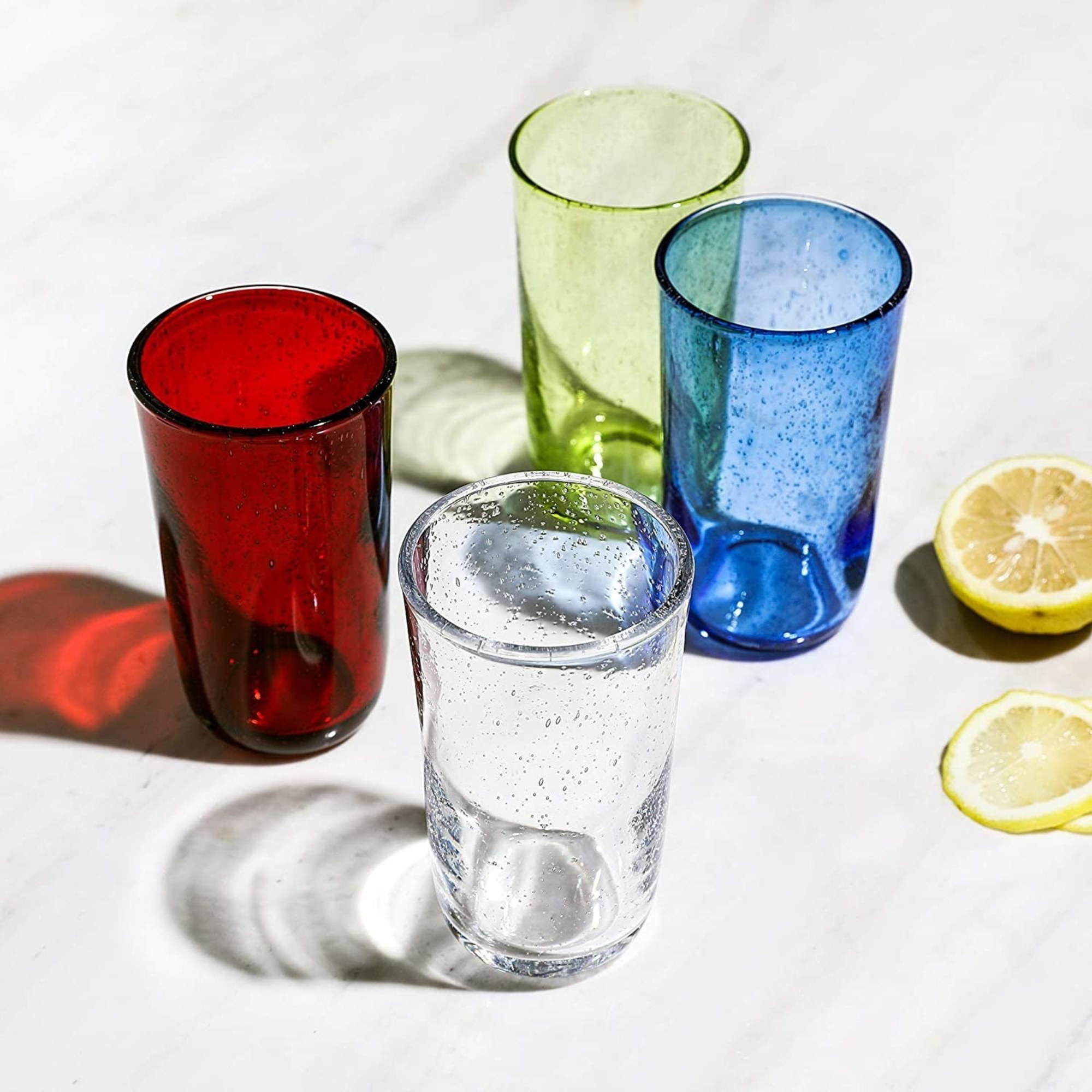 Set of glasses with small bubbles in the glass in clear, red, blue, and green