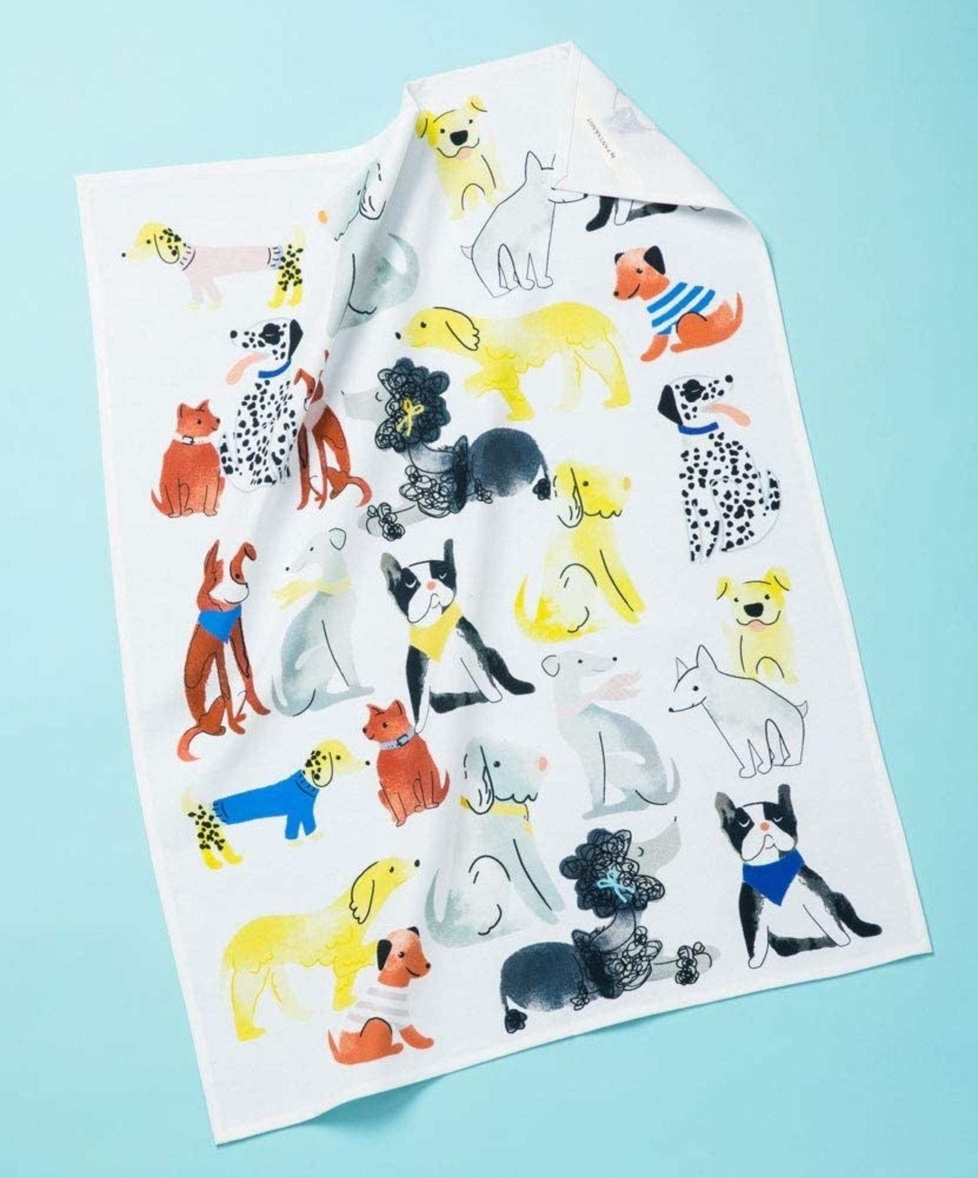 White cotton towel with illustrations of different kinds of dogs all over it