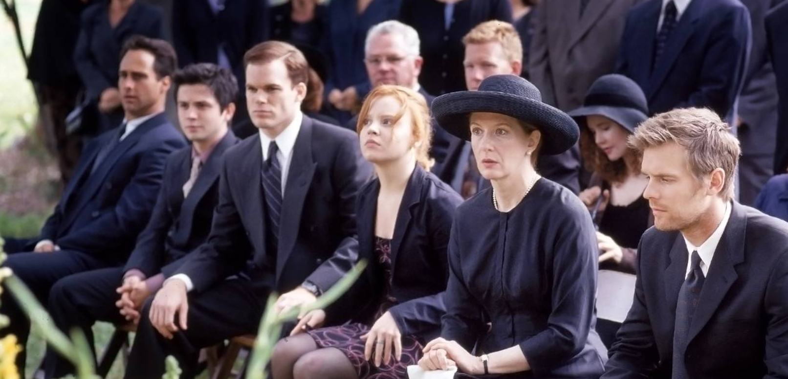 Screenshot of the Fisher family at the patriarch's funeral