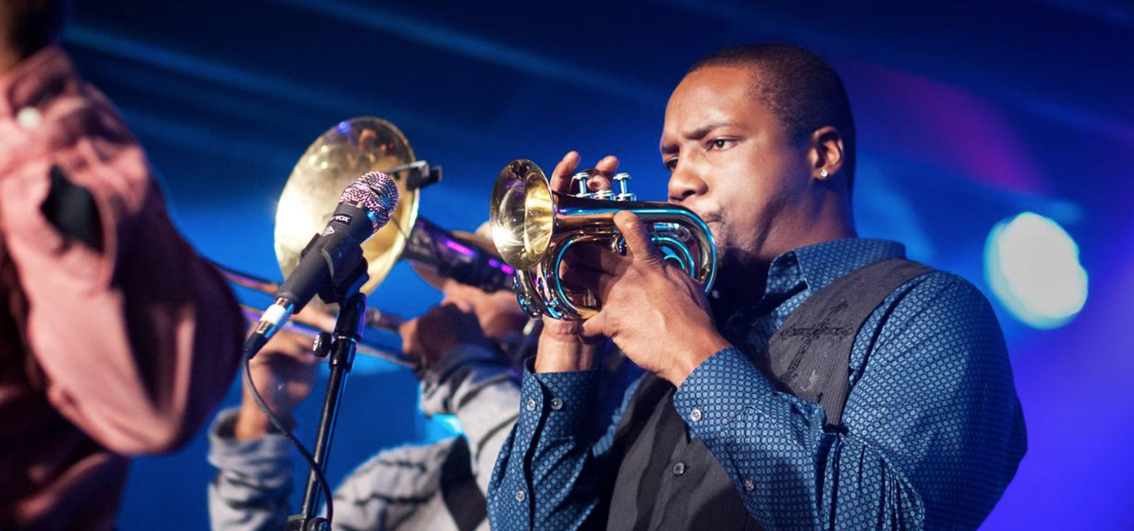 Screenshot of Delmond playing the trumpet