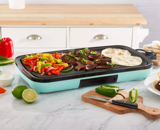 Blue Dash Everyday Electric Griddle cooking peppers, meat strips, and tortillas